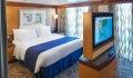 Navigator of the Seas Owner Suite bedroom